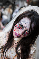A Salvadoran girl, with blood face paint, performs an indigenous mythology character called La Llorona in the La Calabiuza parade at the Day of the Dead celebration in Tonacatepeque, El Salvador, 1 November 2016. The festival, known as La Calabiuza since the 90s of the last century, joins Salvador's pre-Hispanic heritage and the mythological figures (La Sihuanaba, El Cipitío, La Llorona etc.) collected from the whole Central American region, together with the catholic All Saints Day holiday and its tradition of honoring the dead relatives. Children and youths only, dressed up in scary costumes and carrying painted carts, march from the local cemetery to the downtown plaza where the party culminates with music, dance, drinking and eating pumpkin (Ayote) with honey.