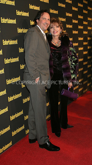 WWW.ACEPIXS.COM . . . . . ....NEW YORK, FEBRUARY 27, 2005....Joan Collins and Percy Gibson at Entertainment Weekly's Academy Awards party at Elaine's.....Please byline: ACE009 - ACE PICTURES.. . . . . . ..Ace Pictures, Inc:  ..Philip Vaughan (646) 769-0430..e-mail: info@acepixs.com..web: http://www.acepixs.com