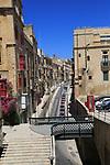 Historic buildings red telephone box iron bridge in city centre of Valletta, Malta