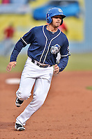 Asheville Tourists designated hitter Josh Fuentes (19) runs to third during a game against the Kannapolis Intimidators at McCormick Field on May 19, 2016 in Asheville, North Carolina. The Intimidators defeated the Tourists 10-7. (Tony Farlow/Four Seam Images)