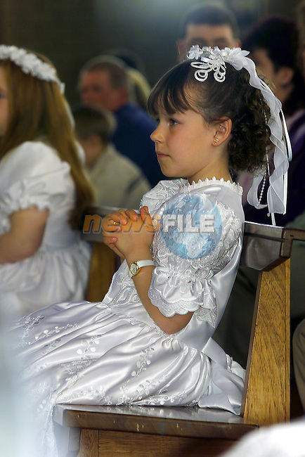 Ciara Finnegan making her first communion in the Holy Family church.Pic Fran Caffrey Newsfile