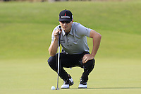 Zach Johnson (USA) lines up his putt on the 14th green during Thursday's Round 1 of the 145th Open Championship held at Royal Troon Golf Club, Troon, Ayreshire, Scotland. 14th July 2016.<br /> Picture: Eoin Clarke | Golffile<br /> <br /> <br /> All photos usage must carry mandatory copyright credit (&copy; Golffile | Eoin Clarke)