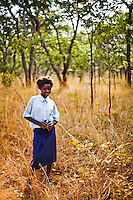 "13 year old Priscilla Mwansa from Chalilo school in Sereje district, on her first safari in Kasanka National Park. ""Other people's view is that the National Park is a hindrance because they would be going into the park and then selling the meat for a profit. [The animals] are beautiful to watch, and they are a symbol that God is great. We shouldn't kill them. I would not accept poachers' meat now. I would now find out where the animal came from and deny that kind of meat."" Local schools and women's groups are regularly brought into Kasanka, which is unique in the country and unusual in Africa as it is privately managed and owned by a trust. People are able to see animals flourishing in land which was once free reign for poachers. Combined with anti-poaching scouts, the education programme is on the frontline of conservation methods in the park, showing local people wild animals in their natural habitat."