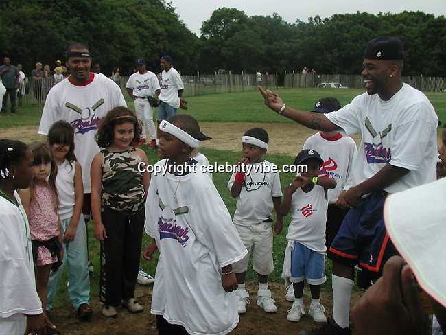 Damon Dash & Kids.Bad Boy vs. Rocafella Baseball Game.To benefit disadvantaged kids.Stony Park.Easthampton, NY.July 4th, 2001.Photo by Celebrityvibe.com..