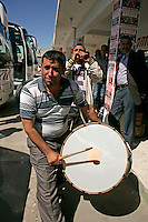 Street musicians at the bus station in Kahta, southeastern Turkey. The instrument at the front is the duval (drum) and the back is the zurna (horn).