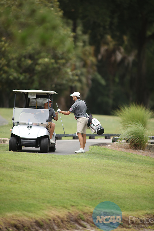 HOWEY IN THE HILLS, FL - MAY 19: Kell Graham of Guilford College fist bumps his coach after a nice shot during the Division III Men's Golf Championship held at the Mission Inn Resort and Club on May 19, 2017 in Howey In The Hills, Florida. (Photo by Cy Cyr/NCAA Photos via Getty Images)