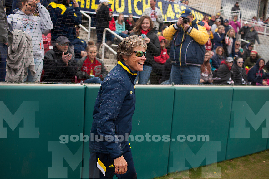 Michigan head coach Carol Hutchins reacts after being doused by her players in celebration of her 1,458th win during an NCAA college softball game on Saturday, April 2, 2016, in Bloomington, Indiana. (Photo by James Brosher)