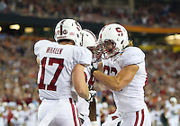 STANFORD, CA - January 2, 2012: Stanford running back Jeremy Stewart (34) celebrates his touchdown with wide receiver Griff Whalen (17) and tight end Coby Fleener (82) against Oklahoma State at the Fiesta Bowl at University of Phoenix Stadium in Phoenix, AZ. Final score Oklahoma State wins 41-38.