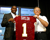 Safety Sean Taylor, left, and Head Coach Joe Gibbs, right, pose with a jersey at a Redskin Park press conference in Ashburn, Virginia introducing Taylor as the Washington Redskins' number one pick in the 2004 NFL draft  on April 26, 2004. .Credit: Arnie Sachs / CNP...