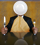 Mindless eating illustration.   Ken Daugherty (cq), manager for Altitute, the restaurant at the new Hyatt Regency Denver at the Colorado Convention Center,  models for photo illustration for Fitness.  (PHOTO ILLUSTRATION BY ELLEN JASKOL/ROCKY MOUNTAIN NEWS).***.