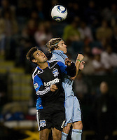 Chris Wondolowski of Earthquakes battles for the ball in the air against Chance Myers of Kansas City during the game at Buck Shaw Stadium in Santa Clara. California on October 1st, 2011.  San Jose Earthquakes tied Sporting Kansas City, 1-1.