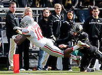 Ohio State Buckeyes wide receiver Philly Brown (10) gets past Purdue Boilermakers punter Cody Webster (42) for a touchdown that was called back on a holding penalty during the first half of the NCAA football game at Ross-Ade Stadium in West Lafayette, IN on Saturday, November 2, 2013. (Columbus Dispatch photo by Jonathan Quilter)