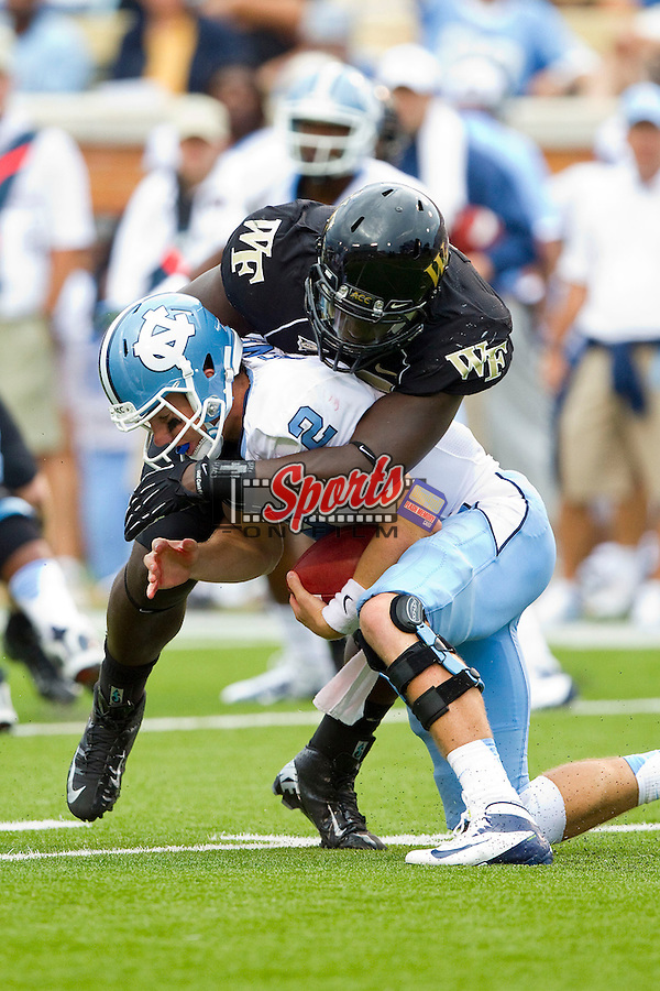 Bryn Renner (2) of the North Carolina Tar Heels is sacked by Tylor Harris (36) of the Wake Forest Demon Deacons at BB&T Field on September 8, 2012 in Winston-Salem, North Carolina.  The Demon Deacons defeated the Tar Heels 28-27.  (Brian Westerholt/Sports On Film)