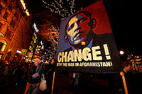 (Dec 10,2009 Oslo,Norway) Protesters with message for US President Barack Obama waves outside Grand Hotel. He received the Nobel Peace Prize during a ceremony in Oslo Town Hall earlier that day. .©Fredrik Naumann/Felix Features.