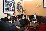 17 November 2007: MLS Commissioner Don Garber (2nd from rt) speaks as Deputy Commissioner Ivan Gazidis (r), DC United broadcaster Dave Johnson (center), Screaming Eagles founder Matt Mathai (left, foreground) and DC United co-managing partner William H.C. Chang listen. The Screaming Eagles, a DC United fan group, hosted the 2007 Supporters Summit, held at Babylon Futbol Club in Falls Church, Virginia one day before MLS Cup 2007, Major League Soccer's championship game.