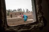 Wednesday 15 July, 2015: A displaced young girl from the heavy fighting and bombarments in Sa'dah governorate are seen in an abandoned salafist madrasa (university) in Dammaj village, used as a temporary settlement in the northern province of Sa'dah, the stronghold of the Houthi's movement in Yemen. (Photo/Narciso Contreras)