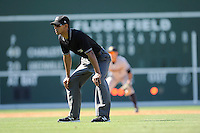 Umpire Ronnie Whiting works the bases in a game between the Charleston RiverDogs and the Greenville Drive on Sunday, June 28, 2015, at Fluor Field at the West End in Greenville, South Carolina. Charleston won 12-9. (Tom Priddy/Four Seam Images)