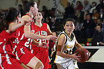 Palos Verdes, CA January 19, 2010 - Lindsey Sugimoto (25) looks for a teammate as Kelsey Brockway (23) defends her during the Palos Verdes vs Peninsula Panthers basketball game at Peninsula High School.