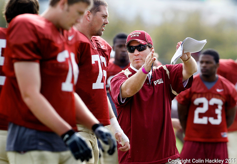 TALLAHASSEE, FLA. 3/26/11-FSU032611 CH-Florida State Head Coach Jimbo Fisher, center, directs during practice Saturday in Tallahassee..COLIN HACKLEY PHOTO