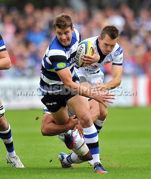Ollie Devoto goes on the attack. Pre-season friendly match, between Bath Rugby and Bristol Rugby on August 17, 2013 at the Recreation Ground in Bath, England. Photo by: Patrick Khachfe / Onside Images