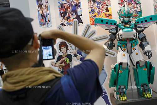 A man takes a picture of a bullet train robot during the Comic Market 94 (Comiket) event at Tokyo Big Sight on August 11, 2018, Tokyo, Japan. The annual event that began in 1975 focuses on manga, anime, game and cosplay. Organizers expect more than 500,000 visitors to attend the 3-day event. (Photo by Rodrigo Reyes Marin/AFLO)