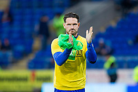 Sean Morrison of Cardiff City claps the fans as he begins to warm up ahead of the Sky Bet Championship match between Cardiff City and Wolverhampton Wanderers at the Cardiff City Stadium, Cardiff, Wales on 6 April 2018. Photo by Mark  Hawkins / PRiME Media Images.