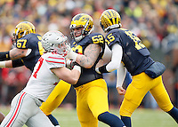 Ohio State Buckeyes defensive lineman Joey Bosa (97) against Michigan Wolverines at Michigan Stadium in Arbor, Michigan on November 28, 2015.  (Dispatch photo by Kyle Robertson)