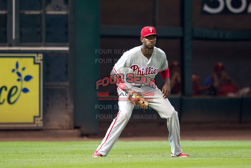 Philadelphia Phillies outfielder Domonic Brown #9 on defense during the Major League baseball game against the Houston Astros on September 16th, 2012 at Minute Maid Park in Houston, Texas. The Astros defeated the Phillies 7-6. (Andrew Woolley/Four Seam Images).