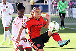 26 October 2014: Veronica Charlyn Corral (MEX) (9) and Khadidra Debessete (TRI) (6). The Trinidad & Tobago Women's National Team played the Mexico Women's National Team at PPL Park in Chester, Pennsylvania in the 2014 CONCACAF Women's Championship Third Place game. Mexico won the game 4-2 after extra time. With the win, Mexico qualified for next year's Women's World Cup in Canada and Trinidad & Tobago face playoff for spot against Ecuador.