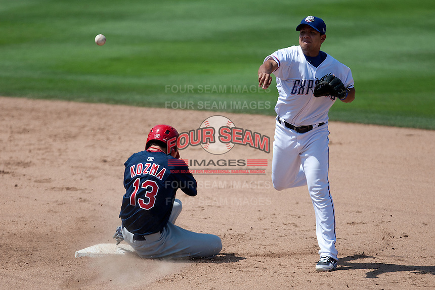 Round Rock Express shortstop Luis Hernandez #9 turns a double play to end the Pacific Coast League baseball game against the Memphis Redbirds on May 6, 2012 at The Dell Diamond in Round Rock, Texas. The Express defeated the Redbirds 5-1. (Andrew Woolley/Four Seam Images).