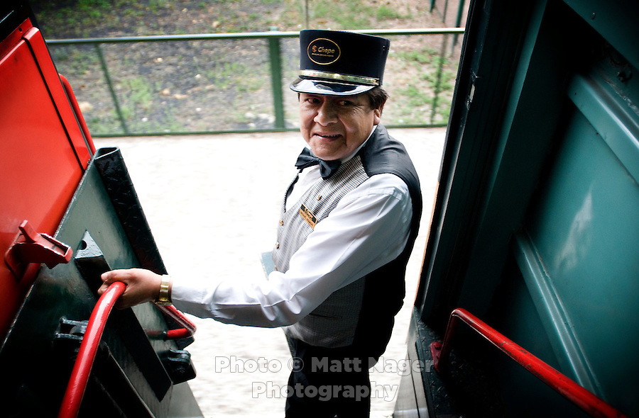 Train attendant Miguel Mando stands outside the First Express train at the Creel train stop in Copper Canyon, Mexico, Saturday, June 21, 2008. Creel is a small mountain town that is a great stopping poin on the journey through Copper Canyon....PHOTOS/ MATT NAGER