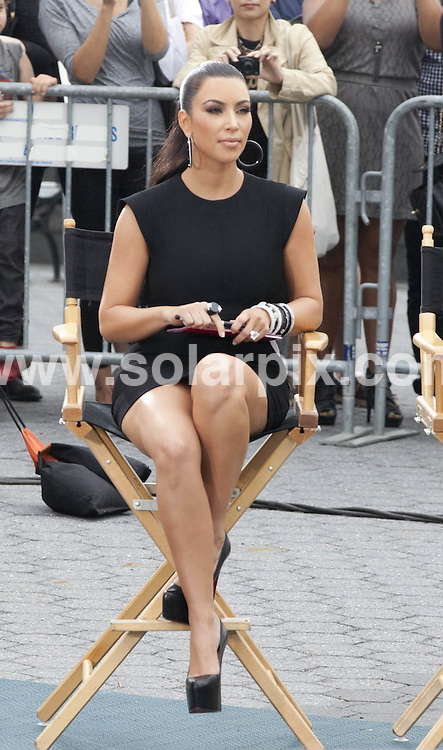 "**ALL ROUND PICTURES FROM SOLARPIX.COM**                                             **SYNDICATION RIGHTS FOR UK, AUSTRALIA, DENMARK, PORTUGAL, S. AFRICA, SPAIN & DUBAI (U.A.E) & ASIA (EXCLUDING JAPAN) ONLY**                                                                                  Caption:  Kim Kardashian, Nina Garcia, Michael Kors, Heidi Klum - ""Project Runway"" Filming at Battery Park in New York City on June 24, 2011 - Battery Park - New York City, NY, USA                                                                             This pic:  Kim Kardashian                                                                                           JOB REF: 13614       PHZ       DATE: 24.06.2011                                                           **MUST CREDIT SOLARPIX.COM OR DOUBLE FEE WILL BE CHARGED**                                                                      **MUST AGREE FEE BEFORE ONLINE USAGE**                               **CALL US ON: +34 952 811 768 or LOW RATE FROM UK 0844 617 7637**"
