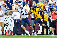 Landover, MD - SEPT 24, 2016: BYU Cougars wide receiver Nick Kurtz (5) almost pulls off an Odell Beckham Jr. type catch while defended by West Virginia Mountaineers cornerback Rasul Douglas (13) during their match up at FedEx Field in Landover, MD. (Photo by Phil Peters/Media Images International)