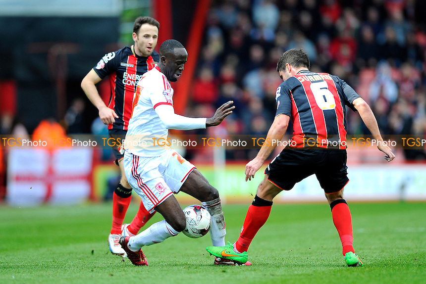 Albert Adomah of Middlesbrough takes on Andrew Surman of AFC Bournemouth - AFC Bournemouth vs Middlesbrough - Sky Bet Championship Football at the Goldsands Stadium, Bournemouth, Dorset - 21/03/15 - MANDATORY CREDIT: Denis Murphy/TGSPHOTO - Self billing applies where appropriate - contact@tgsphoto.co.uk - NO UNPAID USE