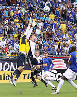 Cruzeiro goalkeeper Rafael and New England Revolution forward Zack Schilawski (15) compete for a high ball.  Brazil's Cruzeiro beat the New England Revolution, 3-0 in a friendly match at Gillette Stadium on June 13, 2010