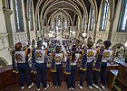 Sept 13, 2014; Trumpets from the Notre Dame Marching Band play the Alma Mater at the end of Mass at Saint John the Evangelist Catholic Church before the Shamrock Series football game in Indianapolis. (Photo by Barbara Johnston/University of Notre Dame