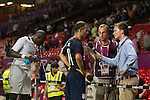Uruguay 2 United Arab Emirates 1, Great Britain 1 Senegal 1, 26/07/2012. Old Trafford, Olympic Games. Great Britain captain Ryan Giggs (blue shirt) conducts a television interview at the side of the pitch at Manchester United's Old Trafford stadium at the end of his team's opening Men's Olympic Football tournament match at the venue. The double header of matches resulted in Uruguay defeating the United Arab Emirates by 2-1 while Great Britain and Senegal drew 1-1. Over 72,000 spectators attended the two Group A matches. Photo by Colin McPherson.
