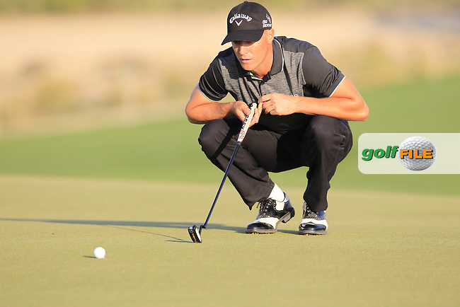 Alex NOREN (SWE) lines up his putt on the 7th green during Wednesday's Round 1 of the 2015 Commercial Bank Qatar Masters held at Doha Golf Club, Doha, Qatar.: Picture Eoin Clarke, www.golffile.ie: 1/21/2015