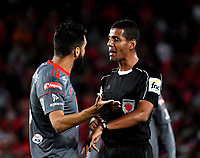 BOGOTA - COLOMBIA - 23 - 01 - 2018: Leonard Mosquera, arbitro, dialoga con Diego Herner (Izq.), jugador de America de Cali, durante partido entre America de Cali y Deportivo Cali, por el Torneo Fox Sports 2018, jugado en el estadio Nemesio Camacho El Campin de la ciudad de Bogota.   / Leonard Mosquera (R), referee, speaks with Diego Herner (L) player of America de Cali, during a match between America de Cali y Deportivo Cali, for the Fox Sports Tournament 2018, played at the Nemesio Camacho El Campin stadium in the city of Bogota. Photo: VizzorImage / Luis Ramirez / Staff.