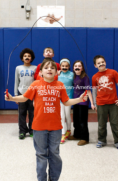"Middlebury, CT- 11 February 2014-021114CM02-  Michael Iwanicki a 4th grader at Middlebury Elementary School participates in Jump For Heart at the school in Middlebury on Tuesday.  Looking on are his teammates, called the ""Jumping Mustaches"".   Jump For Heart is a national fundraising program aimed at promoting physical activity, heart healthy living, and community service to children.  Over 100 children participated in the even said PE teacher, Marc Stockno. Christopher Massa Republican-American"