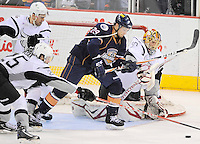 San Antonio Rampage goaltender Jacob Markstrom, right, defends the net against Oklahoms City Barons' Chris VandeVelde (29) during the second period of an AHL hockey game, Monday, May 7, 2012, in San Antonio. (Darren Abate/pressphotointl.com)