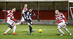 Paul McMullan gets a shot away for Dunfermline