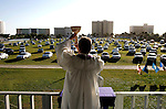 United States - Daytona Beach FL - A former Drive-in movie theatre has been transformed into a drive-in church. Every Sunday referend Larry Deitch preaches to people sitting in their cars. COPYRIGHT GERRIT DE HEUS