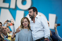 """Matteo Salvini (Leader of the Lega/League, former Deputy Prime Minister & Minister of the Interior of Italy) & Giorgia Meloni MP (Leader of Fratelli d'Italia party, Minister of Youth in Silvio Berlusconi IV Government, 2008-2011).<br /> <br /> Rome, 19/10/2019. Today, tens thousands of people (200,000 for the organisers, 50,000 for the police) gathered in Piazza San Giovanni to attend the national demonstration """"Orgoglio Italiano"""" (Italian Pride) of the far-right party Lega (League) of Matteo Salvini. The demonstration was supported by Silvio Berlusconi's party Forza Italia and Giorgia Meloni's party Fratelli d'Italia (Brothers of Italy, right-wing).  <br /> The aim of the rally was to protest against the Italian coalition Government (AKA Governo Conte II, Conte's Second Government, Governo Giallo-Rosso, 1.) lead by Professor Giuseppe Conte. The 66th Government of Italy is a coalition between Five Star Movement (M5S, 2.), Democratic Party (PD – Center Left, 3.), and Liberi e Uguali (LeU – Left, 4.), these last two parties replaced Lega / League as new members of a coalition based on Parliamentarian majority as stated in the Italian Constitution. The Governo Conte I (Conte's First Government, 5.) was 14-month-old when, between 8 and 9 of August 2019, collapsed after the Interior Minister Matteo Salvini withdrew his euroskeptic, anti-migrant, right-wing Lega / League (6.) from the populist coalition in a pindaric attempt (miserably failed) to trigger a snap election.<br /> <br /> Footnotes & Links:<br /> 1. http://bit.do/feK6N<br /> 2. http://bit.do/e7JLx<br /> 3. http://bit.do/e7JKy<br /> 4. http://bit.do/e7JMP<br /> 5. http://bit.do/e7JH7<br /> 6. http://bit.do/eE7Ey<br /> https://www.leganord.org<br /> http://bit.do/feK9X (Source, TheGuardian.com)<br /> Reportage: """"La Fabbrica Della Paura"""" (The Factory of Fear): http://bit.do/feLcy (Source Report, Rai.it - ITA)<br /> (Update) Reportage: """"La Fabbrica Social Della Paura"""" (The Social Network Factory of Fear): http://b"""