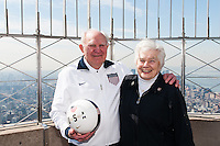 Former men's national team player Walter Bahr poses for a photo with his wife Davies on the observation deck of the Empire State Building during the centennial celebration of U. S. Soccer in New York, NY, on April 05, 2013.