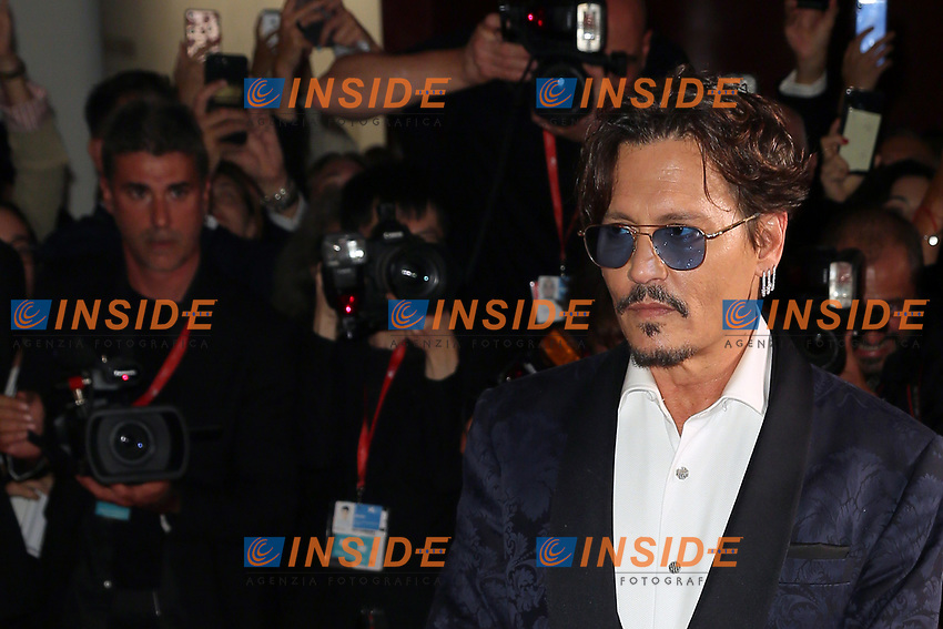 """VENICE, ITALY - SEPTEMBER 06: Johnny Depp walks the red carpet ahead of the """"Waiting For The Barbarians"""" screening during the 76th Venice Film Festival at Sala Grande on September 06, 2019 in Venice, Italy. (Photo by Mark Cape/Insidefoto)<br /> Venezia 06/09/2019"""