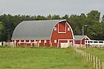 Gambrel roofed red wooden barn, white trim, North Dakota