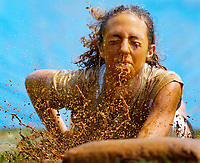 Chealsea Cady gets a nose, mouth, and face full of mud as she practices a head first slide during the Fauquier Falcons Softball Camp July 7, 2005 at Fauquier High School in Warrenton, VA.