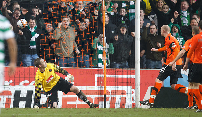 Dusan Pernis beaten by Mark Wilson's deflected shot for Celtic's second goal