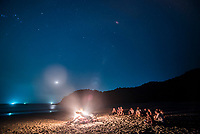 Sitting under stars around a fire on Paradise Beach at night, Dawei Peninsula, Tanintharyi Region, Myanmar (Burma)